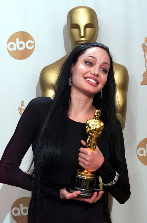 "EMBARGOED AT THE REQUEST OF THE MOTION PICTURE ACADEMY FOR TELEVISION AND INTERNET USE UNTIL THE CONCLUSION OF THE ACADEMY AWARDS TELECAST--Angelina Jolie poses with her award for best actress in a supporting role in ""Girl, Interrupted,"" during the 72nd Academy Awards at the Shrine Auditorium in Los Angeles, Sunday, March 26, 2000. (AP Photo/Kevork Djansezian)"