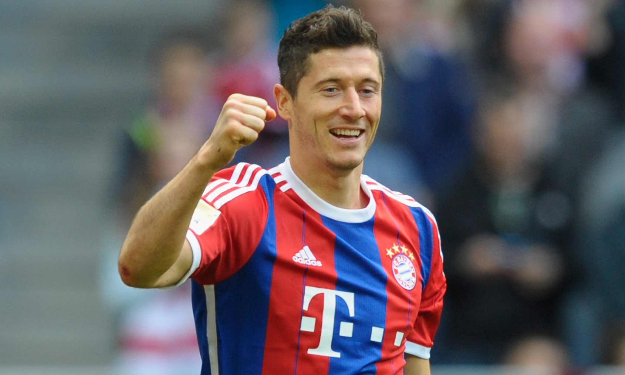 MUNICH, GERMANY - APRIL 11: Robert Lewandowski of Munich celebrates scoring his team's second goal during the Bundesliga match between FC Bayern Muenchen and Eintracht Frankfurt at Allianz Arena on April 11, 2015 in Munich, Germany. (Photo by Lennart Preiss/Bongarts/Getty Images)